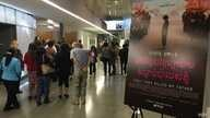 Audience members arrive for a screening of'First They Kil