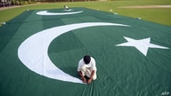 Pakistani workers make a huge national flag ahead of forthcoming celebrations of the country's Independence Day in Karachi, Aug. 8, 2014.