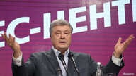 FILE - Ukraine's president and presidential candidate Petro Poroshenko delivers a speech following the announcement of the first exit poll in a presidential election at his campaign headquarters in Kyiv, Ukraine, March 31, 2019.