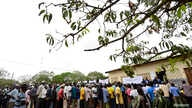 Voters queue to cast their ballots in municipal elections at a voting station near Gorongosa in central Mozambique, Nov. 20, 2013.