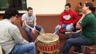 Native students drum and sing together in a ceremony at the University of Wisconsin-Madison.