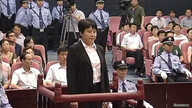 Gu Kailai (front, C), wife of ousted Chinese Communist Party Politburo member Bo Xilai, attends a trial in the court room at Hefei Intermediate People's Court, August 9, 2012