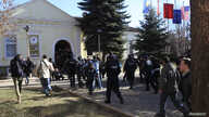 FILE - Students and police are seen in the courtyard of the Dean's Office at the University of Pristina, Feb. 3, 2014. On Wednesday, a letter, allegedly threating an attack by IS, was found in the school as it marked its 47th anniversary.