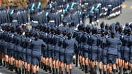 Sri Lankan military personnel march during the country's 66th Independence Day celebrations in the central town of Kegalle, about 40 kms from the capital Colombo on February 4, 2014.
