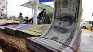 FILE - Banknotes are displayed on a roadside currency exchange stall along a street in Juba, South Sudan.