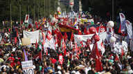 Demonstrators carry banners as they march to Madrid's Colon Square during a protest against government's cost-cutting measures, September 15, 2012. (Reuters)