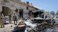 Somali security forces attend the scene of a car bomb attack on a restaurant in Mogadishu, Somalia,  April 5, 2017.