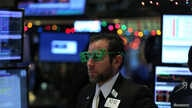 """A trader wears a pair of """"2017"""" glasses in anticipation of the New Year at the New York Stock Exchange in Manhattan, New York, Dec. 30, 2016."""