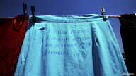 "A skirt, which reads: ""This skirt has a closed history since Spring 1998. Dardania-Peja"", is pictured at an art installation of women dresses, named ""Thinking of You"" by Kosovo-born, London-based artist Alketa Mrripa-Xhafa, in Pristina, Kosovo, June"