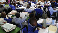 Pupils of Winnie Ngwekasi Primary School in Soweto study in a classroom in Johannesburg, South Africa, November 2009.
