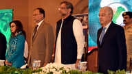 In this photo released by Press Information Department, Pakistani Prime Minister Shahid Khaqan Abbasi, center, attends the International Counter Terrorism Forum in Islamabad, Pakistan, April 5, 2018.