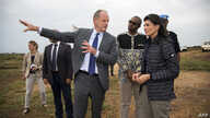 UN envoy for South Sudan David Shearer (L) briefs US Ambassador to the UN, Nikki Haley during a visit to the UN Protection of Civilians (PoC) site in Juba, South Sudan, on October 25, 2017.