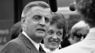 Former Vice President Walter Mondale, left, and his wife, Joan Mondale, face reporters following the presidential candidates appearance on the NBC-TV program Meet the Press, Sept. 10, 1984, Washington, D.C.