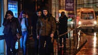 Young people leave the scene of an attack in Istanbul, early Jan. 1, 2017. Turkey's state-run news agency said an armed assailant has opened fire at a nightclub in Istanbul's Ortakoy district.