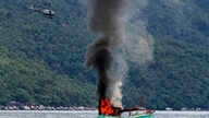 An unmanned Vietnamese fishing boat is blown up and sunk by the Indonesian navy, off the Natuna sea in Anambas, Kepulauan Riau province, Indonesia, Dec. 5, 2014.