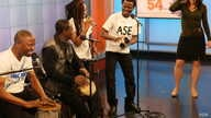 Jomion and the Uklos play a song during their performance on Music Time in Africa for host Heather Maxwell of VOA's Africa 54. (Photo by David Byrd)