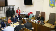 The head of Ukraine's tax and customs service Roman Nasirov (in orange shirt), who is under investigation over the suspected embezzlement of $75 million, attends a court hearing in Kyiv, Ukraine, March 6, 2017.