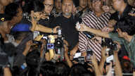 This Antara Foto image shows Bambang Widjojanto, center, deputy chairman of the the Anti-Corruption Commission, speaking to reporters after his release at police headquarters in Jakarta, Jan. 24, 2015.