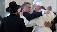 FILE - Pope Francis embraces two good friends of his traveling with him, Argentine Rabbi Abraham Skorka, center, and Omar Abboud, leader of Argentina's Muslim community, partially seen next to the Pope, after praying at the Western Wall in Jerusalem'