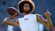 San Francisco 49ers quarterback Colin Kaepernick warms up for a preseason football game against the San Diego Chargers, in San Diego, Calif., Sept. 1, 2016. He's been criticized for refusing to stand for the national anthem.