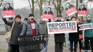 Members of Journalists Without Borders protest against Azerbaijan's President Ilham Aliyev in Berlin, January 21, 2015.