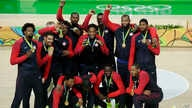 Rio Olympics Basketball Men: The United States' basketball team poses with their gold medals at the 2016 Summer Olympics in Rio de Janeiro, Brazil, Sunday, Aug. 21, 2016.