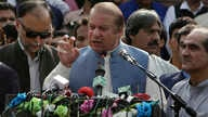 Nawaz Sharif addresses a crowd during his visit to a mausoleum of Pakistani poet Mohammad Iqbal on the occasion of Pakistan Independence Day in Lahore, Aug. 14, 2017.