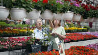 FILE - On the day before Mother's Day, Mary Jane Boots, left, and Clara Carder shop at a greenhouse in Zelienople, Pa., for Mother's Day flowers for the women of their church in Fombell, Pa., May 10, 2014.