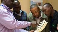 Lancet Commissioner Professor Nyengo Mkandawire from the Malawi College of Medicine teaching at the COOL-funded spine surgery course at AIC-CURE Children's Hospital in Kijabe, Kenya in April 2014. The spine course was led by Professor Chris Lavy from