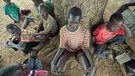 Children suffering from nodding disease gather in Akoya-Lamin Omony village in Gulu district, 384 kilometers north of Uganda's capital of Kampala, February 19, 2012.