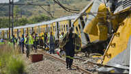 Emergency workers in attendance at the scene of a collision between two passenger trains near Pretoria, South Africa, January 31, 2013.