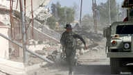 An Iraqi soldier runs through the city of Qaraqosh, as troops search for any Islamic State militants still in the area, near Mosul in Iraq October 30, 2016.