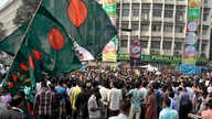 Activists and others gather to celebrate after the Supreme Court cleared the way for the execution of Abdul Quader Mollah, Dhaka, Dec. 12, 2013.