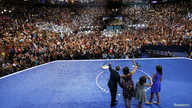 U.S. President Barack Obama (L) waves at supporters as he leads his family across the stage at the Democratic National Convention in Charlotte, North Carolina September 6, 2012.