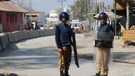 Policemen keep guard near the central prison where a court convicted 31 people over the campus lynching of a university student last year who was falsely accused of blasphemy, in Haripur, Pakistan, Feb. 7, 2018.