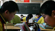 FILE - Children study in small rural primary school in the Chang ling Xia Cou village, north of Beijing, China.