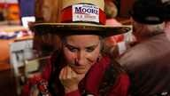Supporter Sherri Martin, of Mobile, Ala., waits for U.S. Senate candidate Roy Moore to speak at a campaign rally, Dec. 5, 2017, in Fairhope Ala.