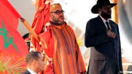 King Mohammed VI of Morocco, left, and South Sudan's President Salva Kiir stand for the national anthem after he arrived at the Juba airport in South Sudan's capital Juba, Feb. 1, 2017.
