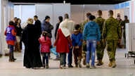 Syrian refugees wait at Marka Airport in Amman, Jordan, to complete their migration procedures to Canada, Dec. 8, 2015.