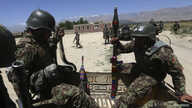 Afghan National Army soldiers patrol near polling stations in the outskirts of Kabul, June 12, 2014.