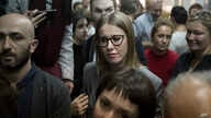 Russian socialite and opposition member Kseniya Sobchak waits outside a court where Russian theater and film director Kirill Serebrennikov attends a hearing, in Moscow, Oct. 17, 2017.
