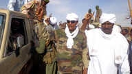 Musa Hilal (C), the leader of the Arab Mahamid tribe in Darfur, salutes his followers upon his arrival in Nyala, the capital of South Darfur state, Dec. 7, 2013.