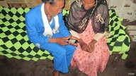A community volunteer offers her neighbors cell phone access to requesting contraceptives in rural Ethiopia. (Photo Credit: Marie Stopes International, Ethiopia)
