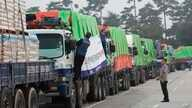 FILE - South Korean trucks with food aid prepare to leave for North Korean city of Kaesong in Paju, South Korea, Sept. 21, 2012.