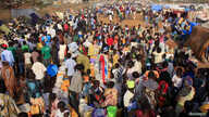 Displaced people walk around Tomping camp in Juba, where some 15,000 people who fled their homes are sheltered by the United Nations, Jan. 7, 2014.