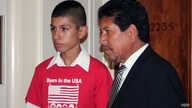 Saul Arellano, left, stands with a pro-immigration activist at a meeting of the Congressional Hispanic Congress in Washington, DC on June 5, 2013. U.S.-born Arellano wants the U.S. to pass a reform bill that would enable his mother, who was deported