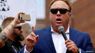 FILE - Alt-right conspiracy theorist Alex Jones speaks during a rally near the Republican National Convention in Cleveland, Ohio, July 18, 2016.