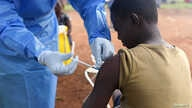 FILE PHOTO: A Congolese health worker administers Ebola vaccine to a boy who had contact with an Ebola sufferer in the village of Mangina in North Kivu province of the Democratic Republic of Congo, Aug.18, 2018.