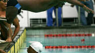 Indonesia's Daniel Patay dives into the pool in the men's 400-meter freestyle functional relay competition during the third ASEAN Para Games in Manila Monday, Dec. 19, 2005.