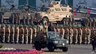 Pakistan's President Mamnoon Hussain, center on a military vehicle, reviews a military parade to mark Pakistan's Republic Day, in Islamabad, Pakistan, March 23, 2017.